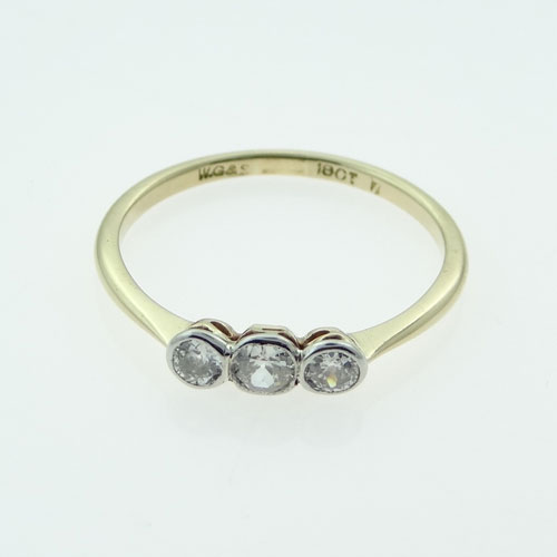 gold three stone diamond ring