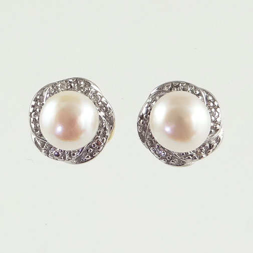 gold pearl and diamond swirl earrings